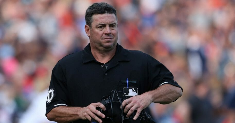 Major League Baseball umpire Rob Drake looks into the dugout during the sixth inning of the game between the Cleveland Indians and the Detroit Tigers on June 13, 2015, at Comerica Park in Detroit, Michigan.