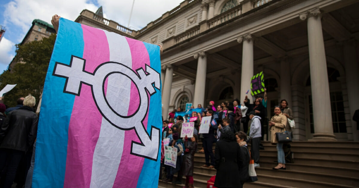 LGBT activists rally in support of transgender rights on the steps of New York City Hall.