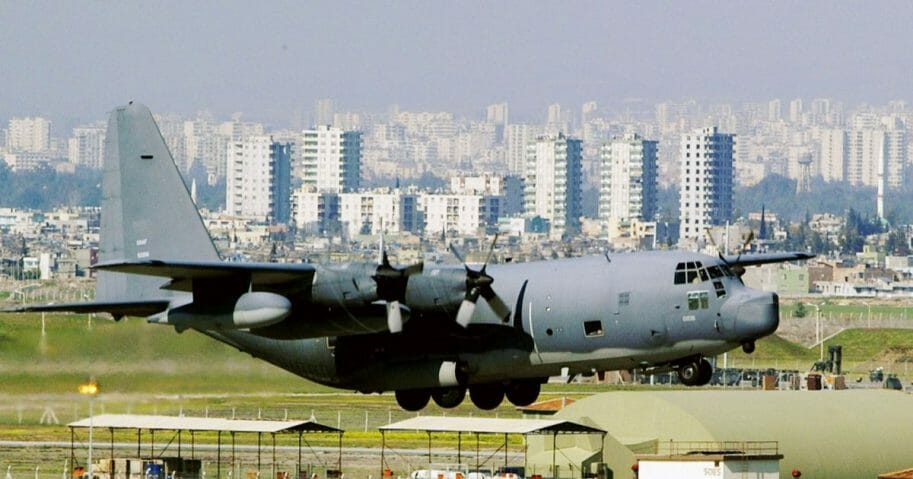 A C-130 glides in for a landing in front of downtown Adana at Incirlik Air Force Base in Turkey.
