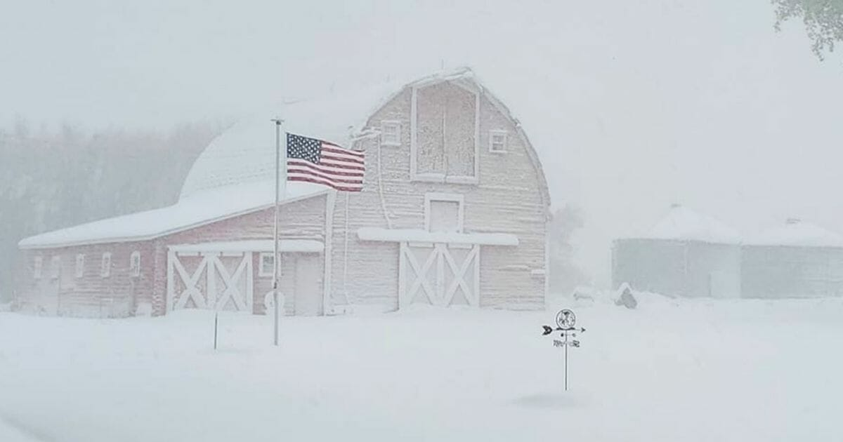 A barn covered in snow after a record blizzard in North Dakota.