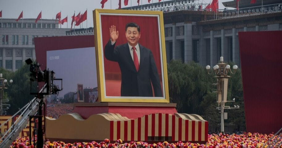 A giant portrait of Chinese President Xi Jinping is carried atop a float at a parade to celebrate the 70th anniversary of the founding of the People's Republic of China at Tiananmen Square on Oct. 1, 2019, in Beijing, China.