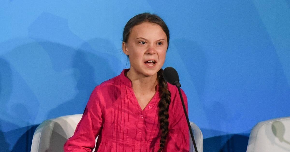 Greta Thunberg giving a speech at the UN.