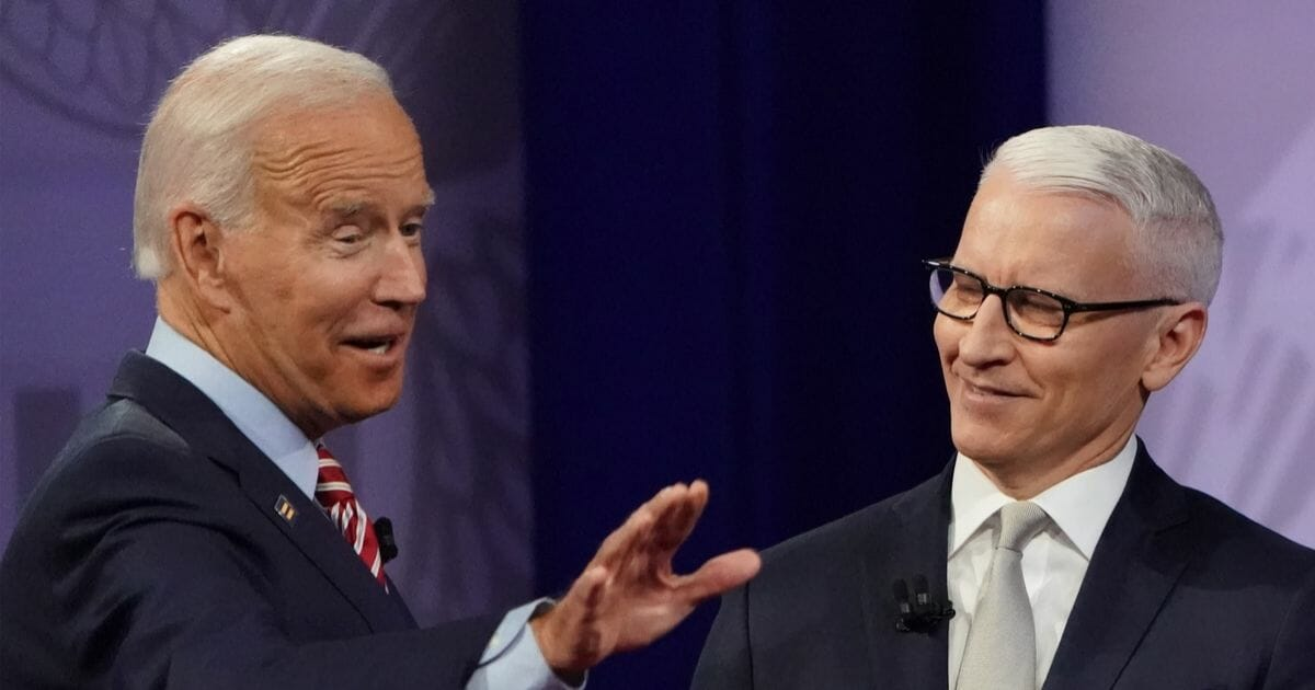 Democratic presidential candidate former Vice President Joe Biden gestures with CNN moderator Anderson Cooper at the Human Rights Campaign Foundation and CNN's LGBT town hall on Oct. 10, 2019, in Los Angeles.