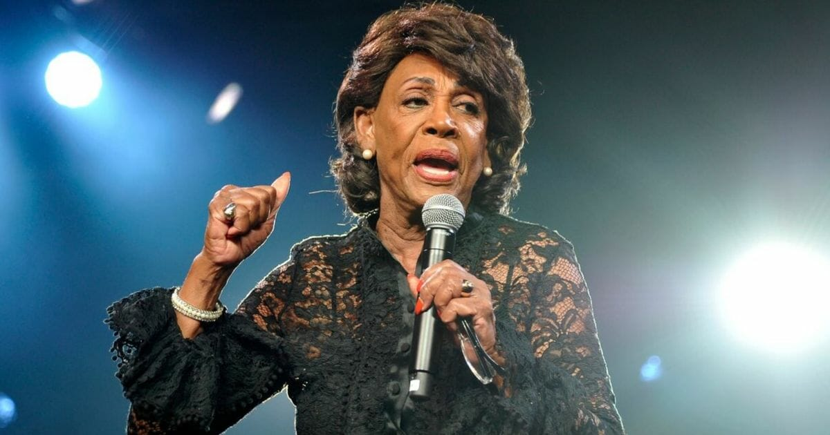 U.S. Rep. Maxine Waters speaks onstage during the Beautycon Festival in Los Angeles in August. Waters published a Twitter post on Tuesday calling for President Donald Trump to not only be impeached, but be imprisoned in solitary confinement.