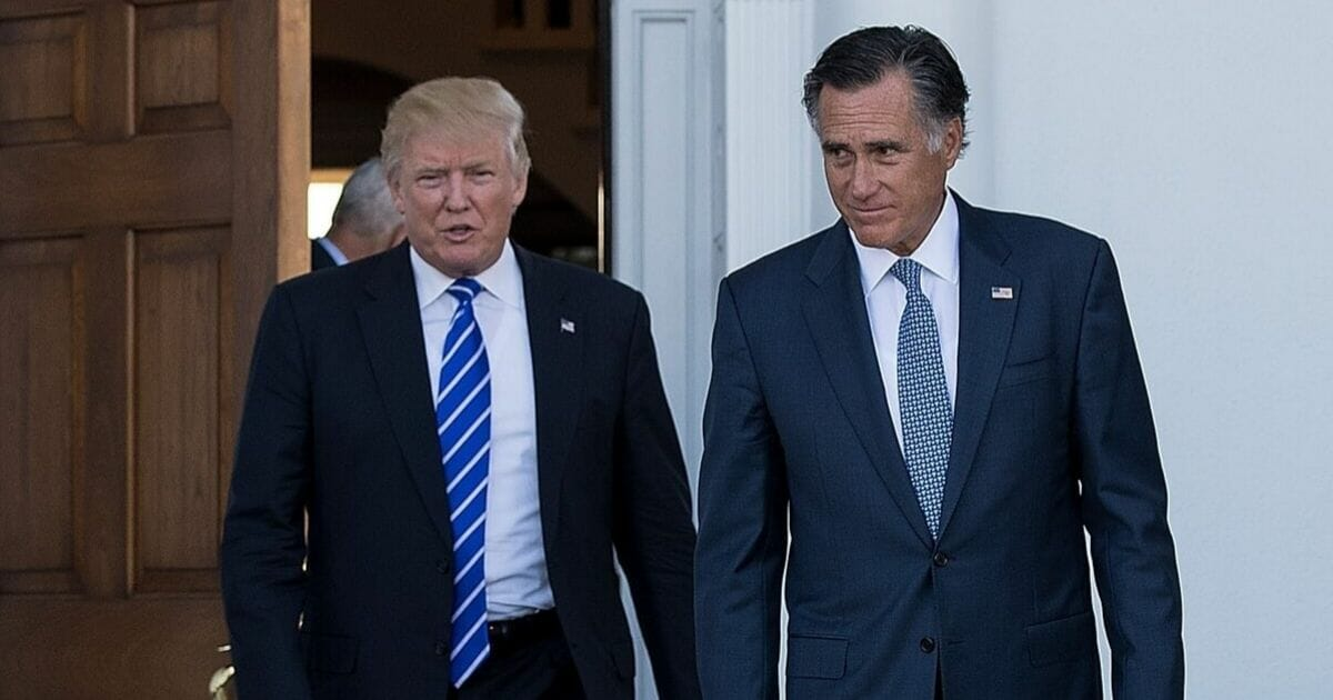 Then-President-elect Donald Trump and former Republican presidential candidate Mitt Romney are pictured after a Nov. 19, 2016, meeting at Trump International Golf Club in Bedminster Township, New Jersey.