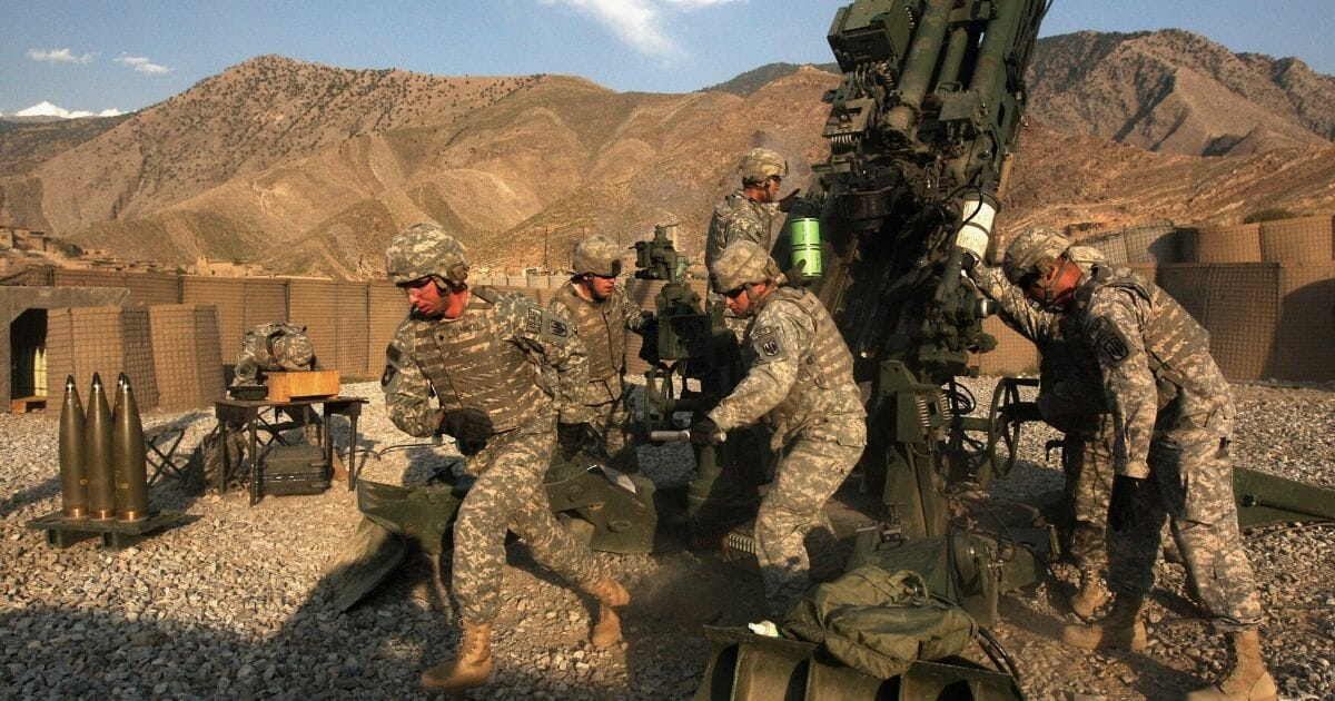 U.S. artillerymen prepare to fire a 155mm howitzer at Taliban positions in October 2008 in the Kunar Province of eastern Afghanistan.