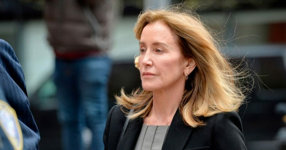 Actress Felicity Huffman is escorted by police into court at the John Joseph Moakley United States Courthouse in Boston on May 13, 2019.