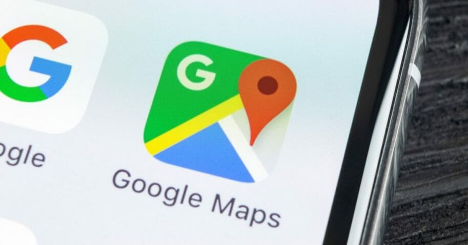 The Google Maps application icon on an Apple iPhone X screen close-up.