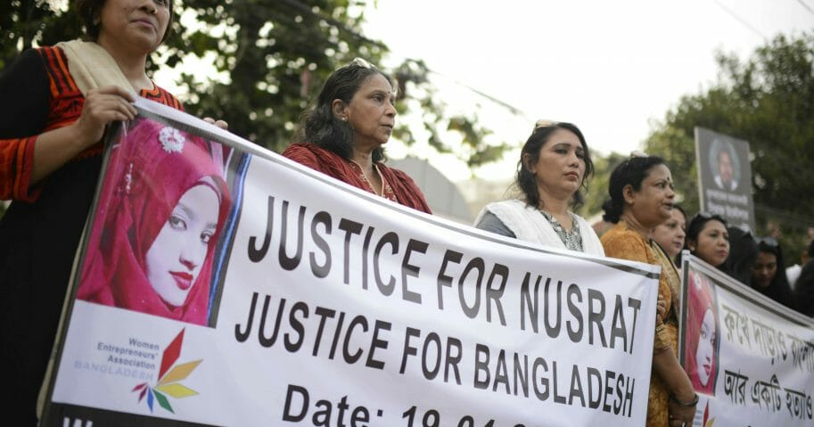 In this April 19, 2019, file photo, protesters gather to demand justice for an 18-year-old woman, Nusrat Jahan Rafi, who was killed after she was set on fire for refusing to drop sexual harassment charges against her Islamic school's principal, in Dhaka, Bangladesh. A court in eastern Bangladesh has sentenced the principal of the Islamic school and 15 others to death for killing Rafi.