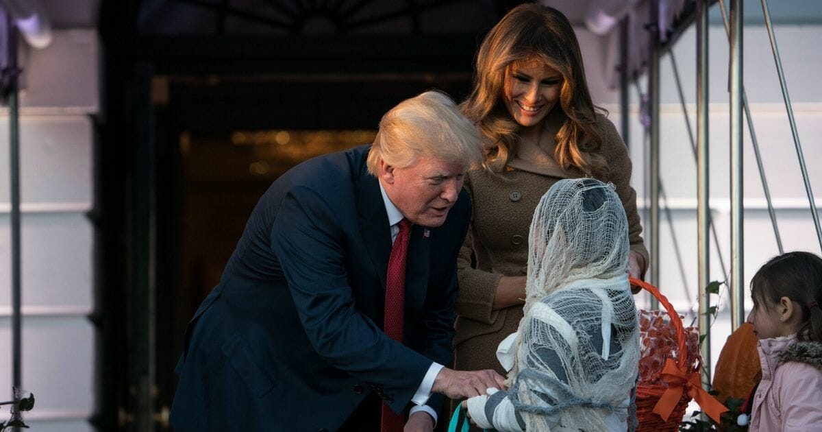 President Donald Trump and first lady Melania Trump hand out candy for children at a Halloween celebration at the White House in Washington, D.C., on Oct. 28, 2019.