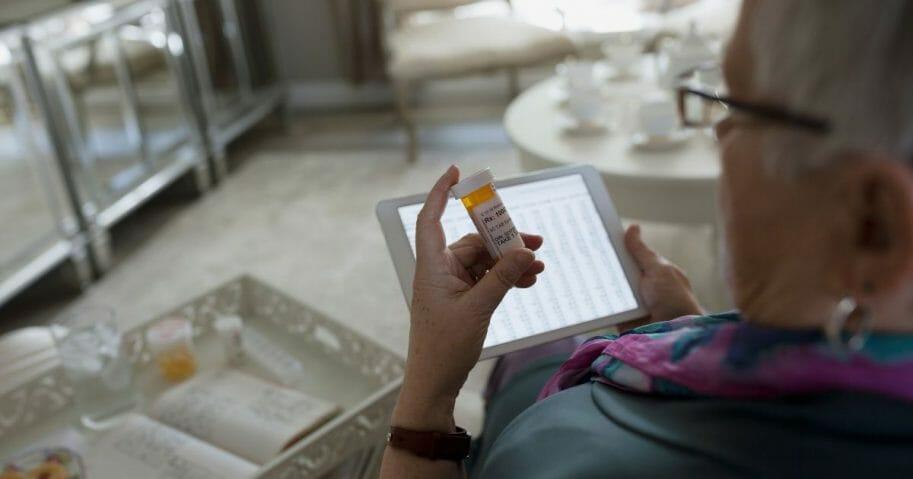 Woman checking prescription label.