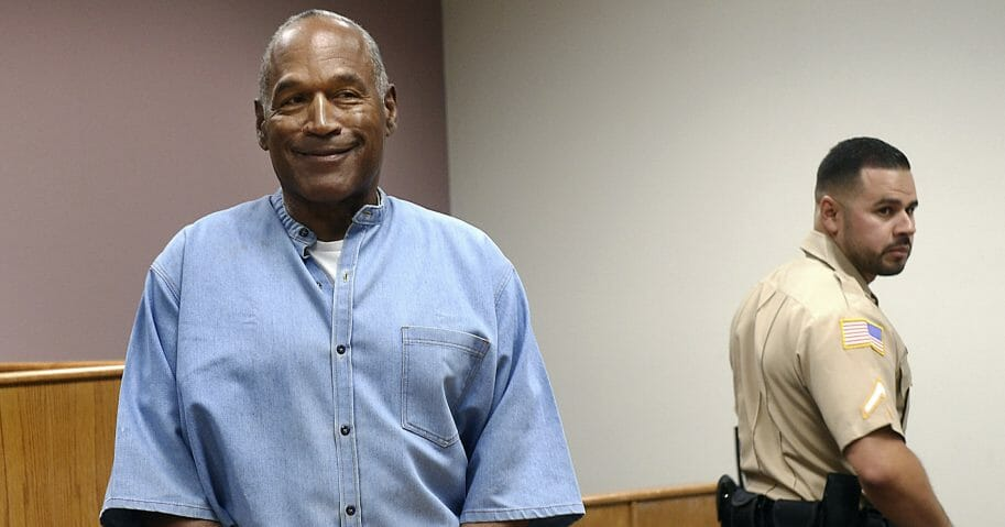 In this July 20, 2017, file photo, former NFL football star O.J. Simpson enters his parole hearing at the Lovelock Correctional Center in Lovelock, Nevada. Simpson is suing a Las Vegas hotel-casino, alleging unnamed employees defamed him by telling celebrity news site TMZ he was ordered off the property in 2017 for being drunk, disruptive and unruly.