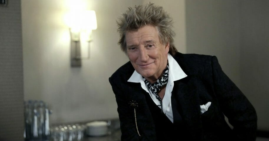 In this photo taken on Nov. 14, 2019, British singer Rod Stewart poses for the media after an interview with The Associated Press at a hotel in London. Stewart, known for decades as a consummate crooner, rocker, fashion plate and tongue-in-cheek sex symbol, is adding a new element to his image: serious model railroad builder. The one-time front man of The Faces who has hits dating back to the 1960s, has put the finishing touch on a 23-year project that has landed him on the cover of Railway Modeller magazine, a far cry from Rolling Stone, whose cover he has graced many times.