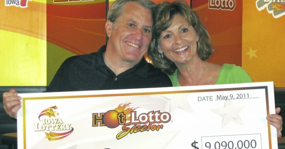 This May 9, 2011, photo shows Larry Dawson and his wife, Kathy, claiming their $9.09 million Hot Lotto jackpot in Des Moines, Iowa.