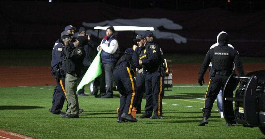 Police investigate the scene after a gunman shot into a crowd of people during a football game at Pleasantville High School in Pleasantville, New Jersey, on Nov. 15, 2019.