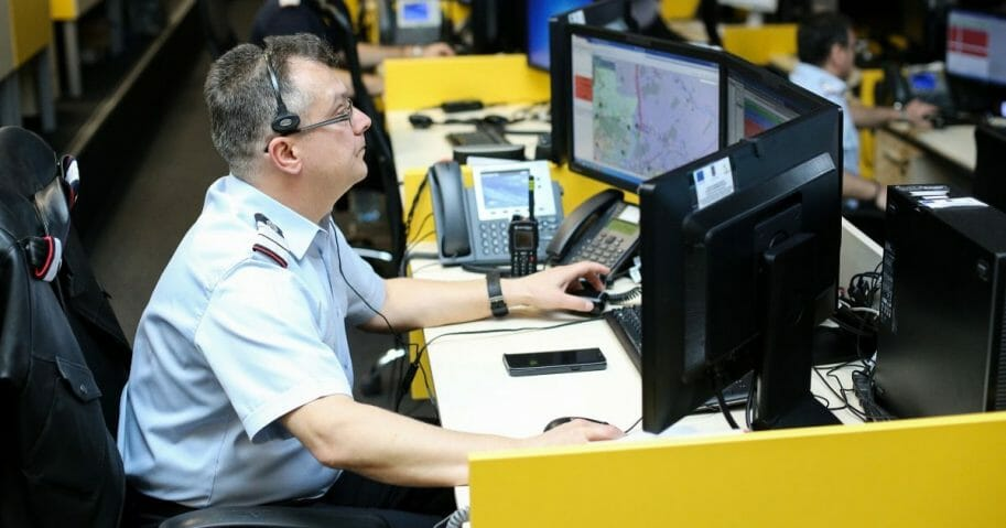 An Ohio woman trying to report alleged domestic violence found a creative way to get the attention of authorities without alerting the suspect in the incident that she was phoning for help. The image above is a stock photo of a 911 dispatcher.