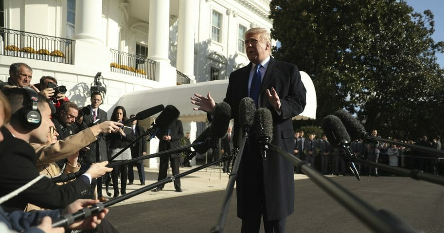 President Donald Trump speaks to reporters on the South Lawn of the White House in Washington on Nov. 8, 2019.