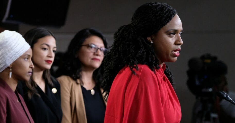 Democratic Rep. Ayanna Pressley of Massachusetts speaks while the other members of the so-called squad -- from left, Reps. Ilhan Omar of Minnesota, Alexandria Ocasio-Cortez of New York and Rashida Tlaib of Michigan -- look on.