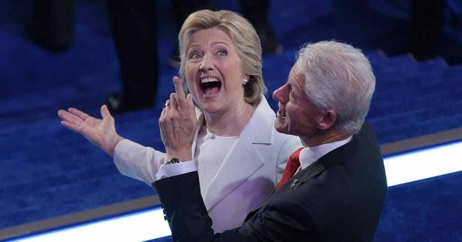 Then-Democratic presidential candidate Hillary Clinton and her husband, former President Bill Clinton, look at the balloons at the end of the Democratic National Convention at the Wells Fargo Center in Philadelphia on July 28, 2016.