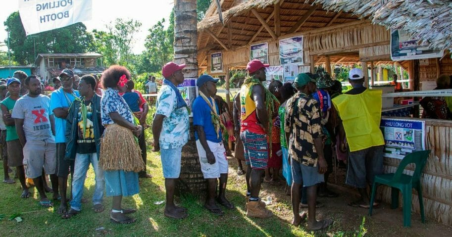People line up to vote at a polling station in the capital Buka in an historical independence vote on Nov. 25, 2019.