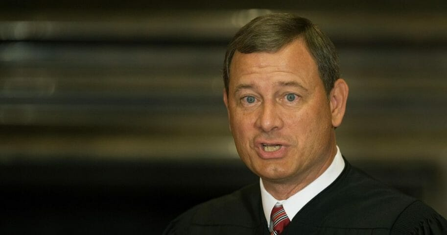 Chief Justice John G. Roberts prepares to swear in Judge Sonia Sotomayor, 55, the first Hispanic justice on the Supreme Court, in the East Conference room of the Supreme Court in Washington on Aug. 8, 2009, as the 111th Justice.