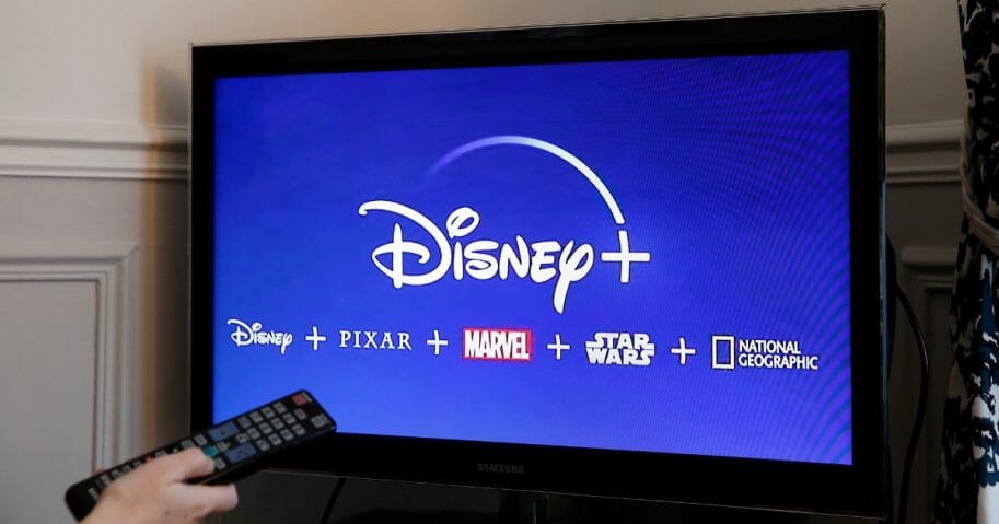 Photo illustration of the Disney Plus logo on a television screen.