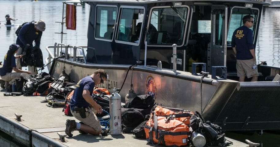 Members of the FBI's Underwater Search and Evidence Response Team prepare to recover the final body from the dive boat Conception on Sept. 5, 2019, in Santa Barbara, California. Thirty-four people died aboard the dive boat Conception when it caught fire offshore at Santa Cruz Island in the early morning hours of Labor Day.