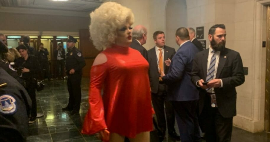 "With the eyes of the political world on Washington, D.C., this week for the first public impeachment hearing, a drag queen who goes by the name ""Pissi Myles"" decided to take advantage."
