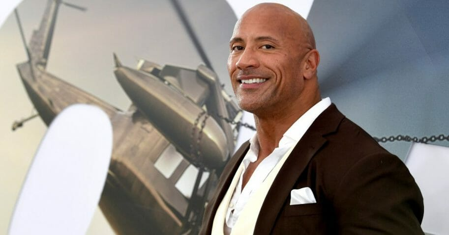 """Dwayne Johnson arrives at the premiere of Universal Pictures' """"Fast & Furious Presents: Hobbs & Shaw"""" at Dolby Theatre on July 13, 2019, in Hollywood, California."""