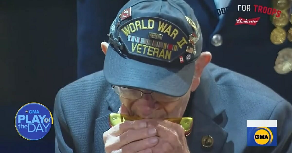 """""""Harmonica Pete"""" DuPré, a 96-year-old veteran of World War II, plays """"The Star-Spangled Banner"""" Sunday night at Madison Square Garden."""