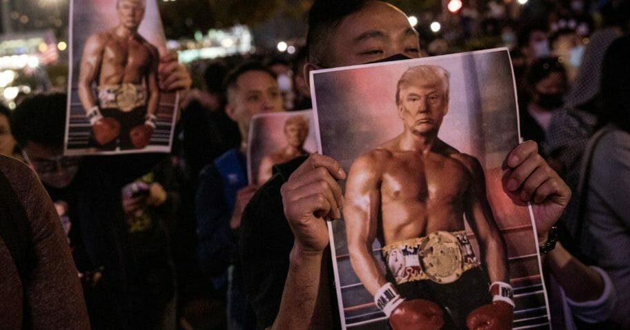 Pro-democracy protesters hold posters of President Donald Trump during a Thanksgiving Day rally at Edinburgh Place on Nov. 28, 2019, in Hong Kong, China.