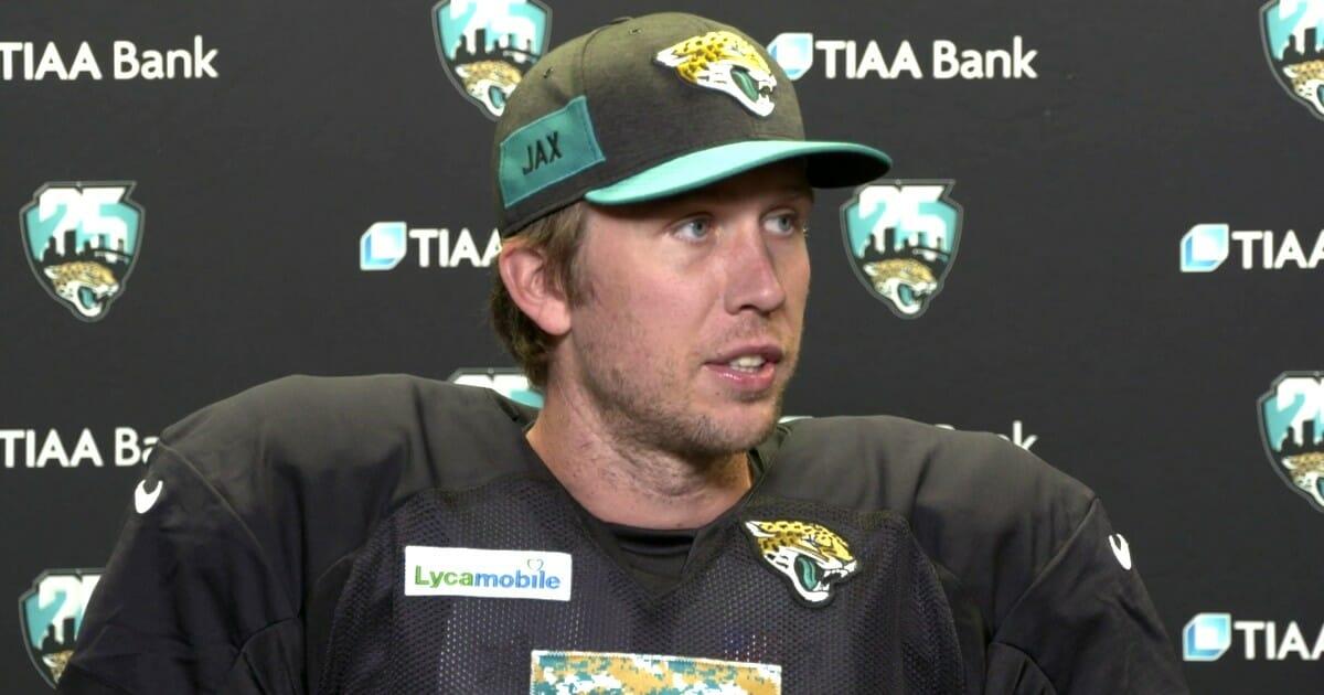 Jacksonville Jaguars quarterback Nick Foles speaks to reporters.