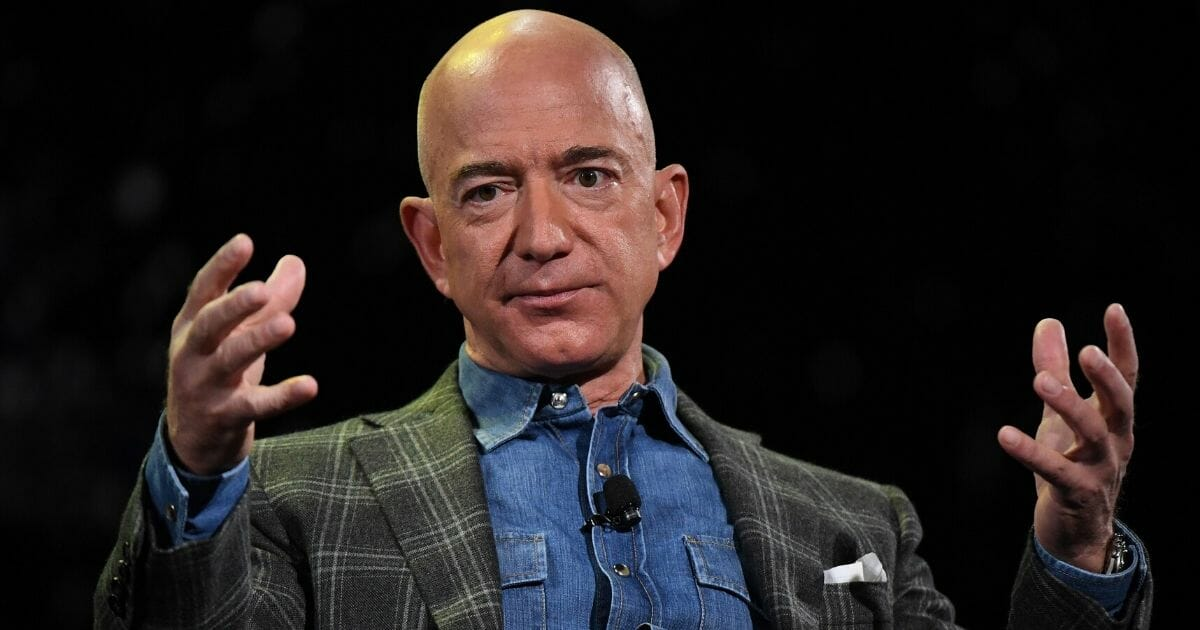 Amazon founder and CEO Jeff Bezos addresses the audience during a keynote session at the Amazon Re:MARS conference on robotics and artificial intelligence at the Aria Hotel in Las Vegas, Nevada, on June 6, 2019.