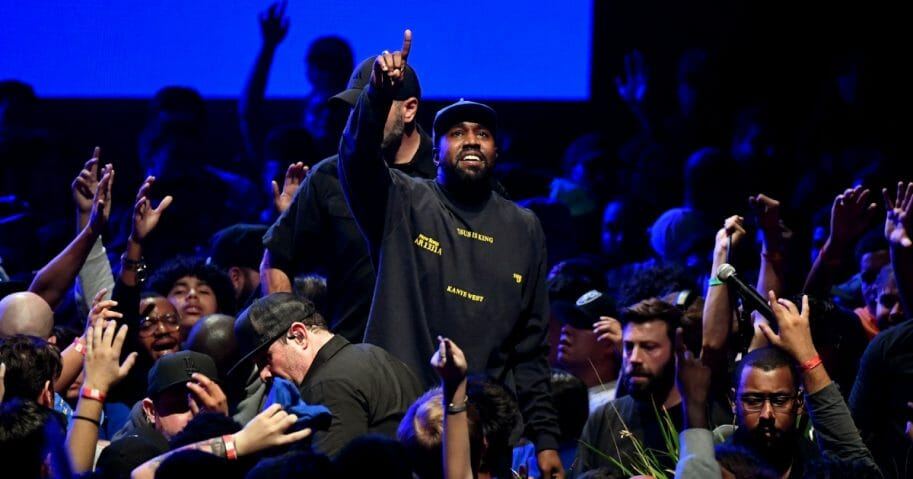 """Kanye West performs onstage during his """"Jesus Is King"""" album and film experience at The Forum in Inglewood, California."""
