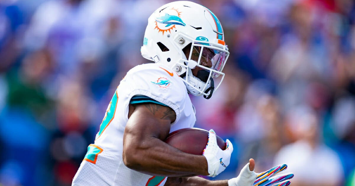 Mark Walton #22 of the Miami Dolphins carries the ball during the first quarter against the Buffalo Bills at New Era Field on Oct. 20, 2019, in Orchard Park, New York.