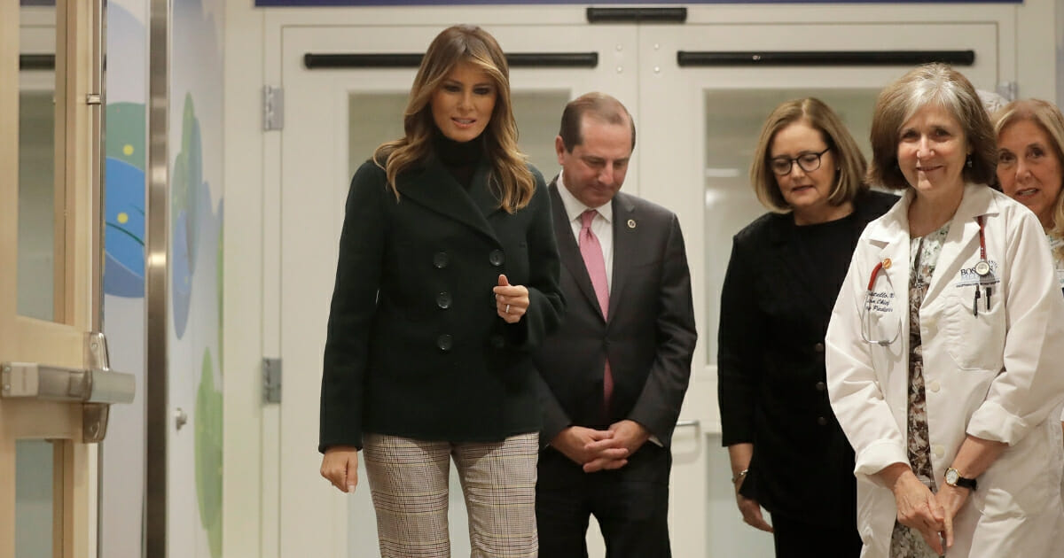 First lady Melania Trump, left, walks with pediatrician Eileen Costello, front right, and Secretary of Health and Human Services Alex Azar, center, during a visit to Boston Medical Center where she was informed about their Cuddling Assists in Lowering Maternal and Infant stress program as part of her Be Best initiative on Nov. 6, 2019, in Boston, Massachusetts.