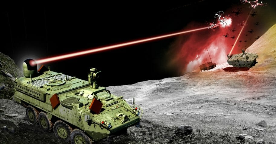 An Army Stryker combat vehicle armed with a directed energy weapon fires upon a drone.