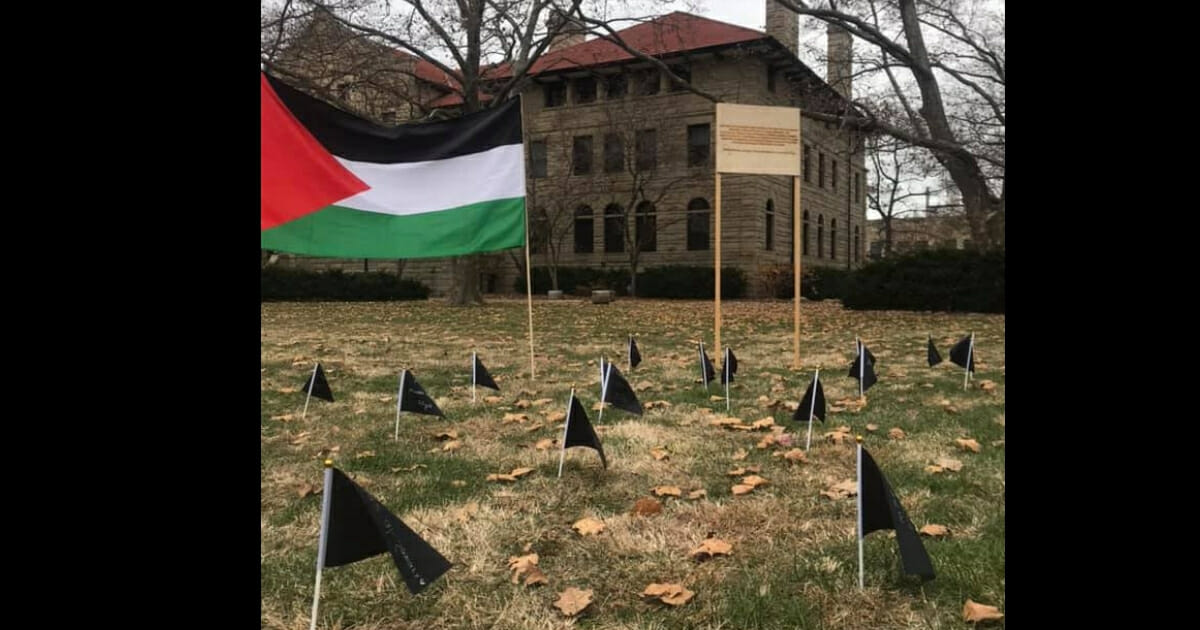 """Students for a Free Palestine at Oberlin College in Ohio set up a display of black flags as """"a commemoration of the 34 Palestinians killed by Israeli rocket fire this last week."""""""