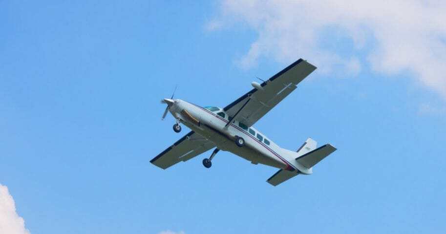 Small turboprop plane against a blue sky