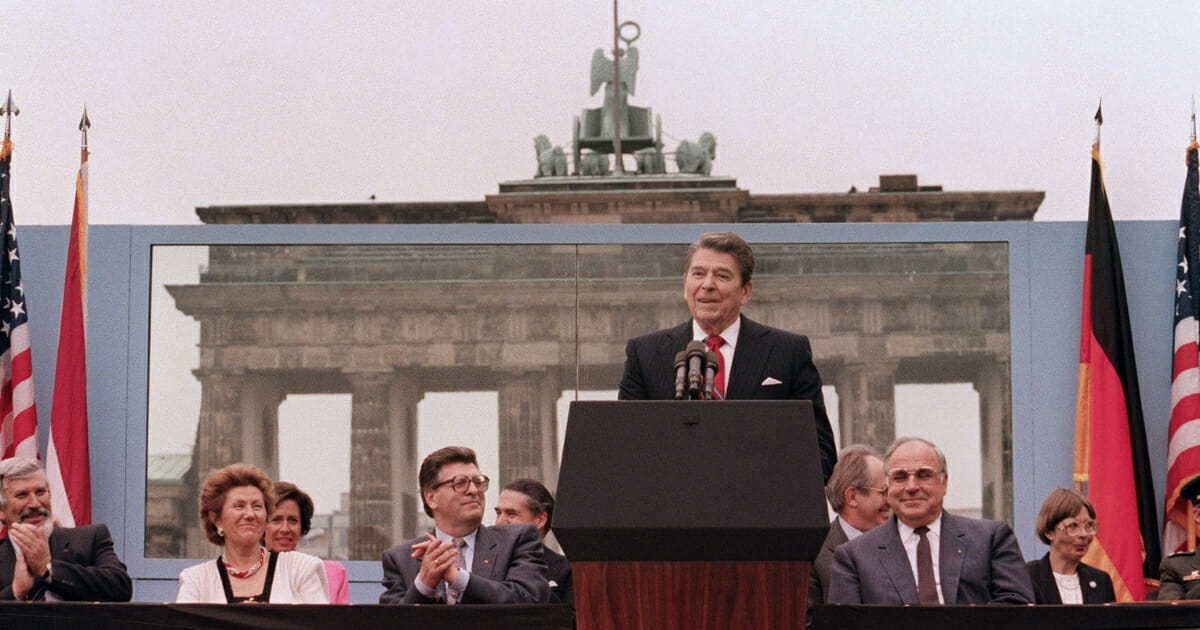 President Ronald Reagan, commemorating the 750th anniversary of Berlin, addresses the people of West Berlin at the base of the Brandenburg Gate, near the Berlin Wall, on June 12, 1987.