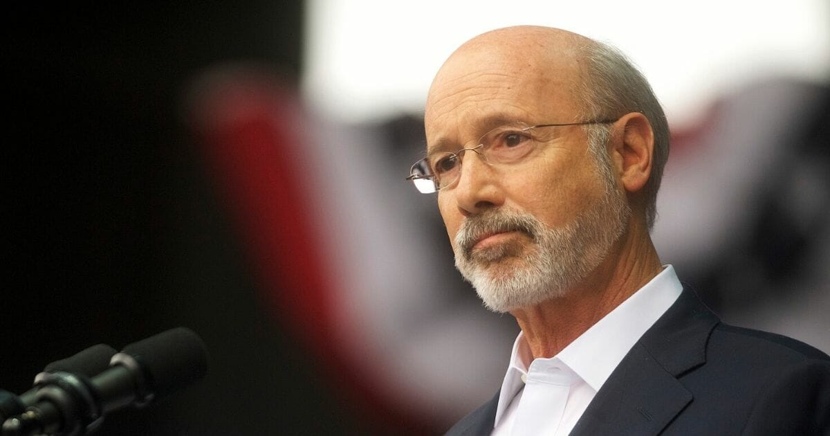 Pennsylvania Gov. Tom Wolf addresses supporters before former President Barack Obama speaks during a campaign rally for statewide Democratic candidates on Sept. 21, 2018, in Philadelphia, Pennsylvania