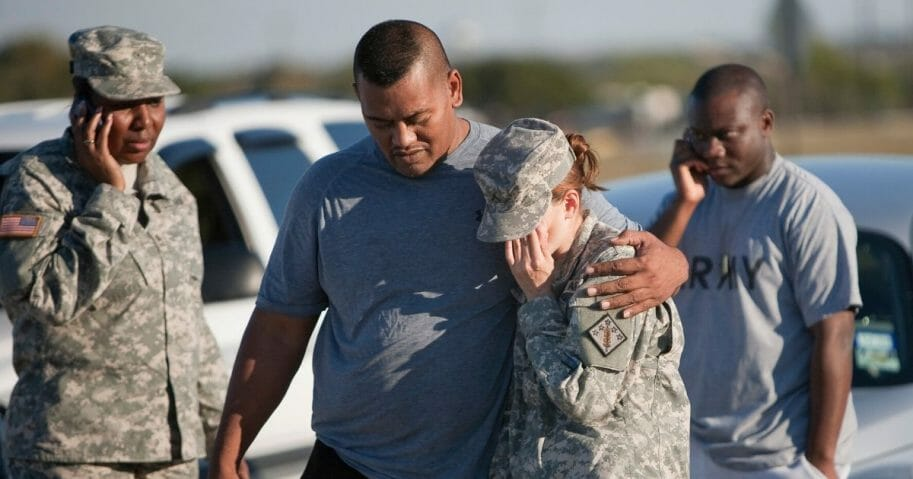 Sgt. Fanuaee Vea puts his arm around Pvt. Savannah Green outside Fort Hood on Nov. 5, 2009, in Killeen, Texas.