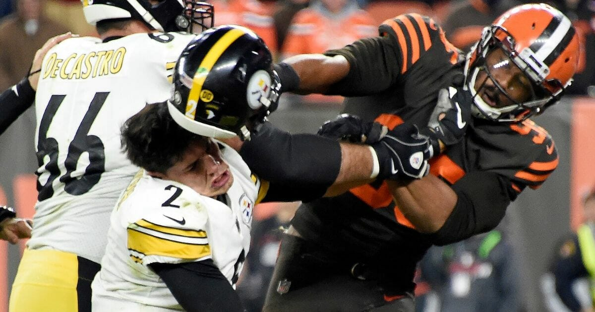 Cleveland Browns defensive end Myles Garret hits Pittsburgh Steelersquarterback Mason Rudolph over the head with Rudolph's own helmet in the closing seconds of Thursday night's game at FirstEnergy Stadium in Cleveland, Ohio.