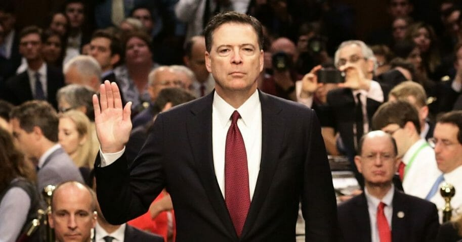 Former FBI Director James Comey is sworn in before testifying before the Senate Intelligence Committee in June 2017, a month after being fired by President Donald Trump.