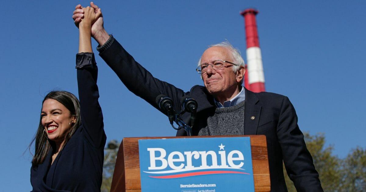Rep. Alexandria Ocasio-Cortez endorses Democratic presidential candidate, Sen. Bernie Sanders at a campaign rally in Queensbridge Park on Oct. 19, 2019.