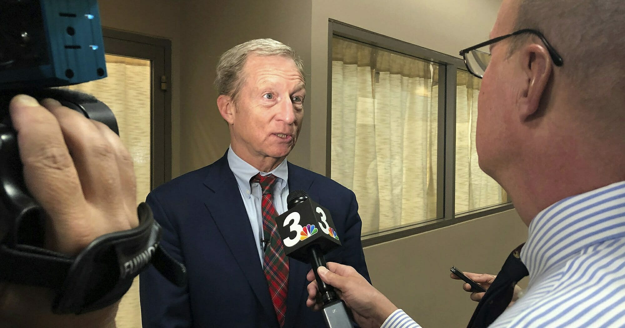 Democratic presidential candidate Tom Steyer speaks to reporters before hosting a town hall in Henderson, Nevada, on Nov. 4, 2019.