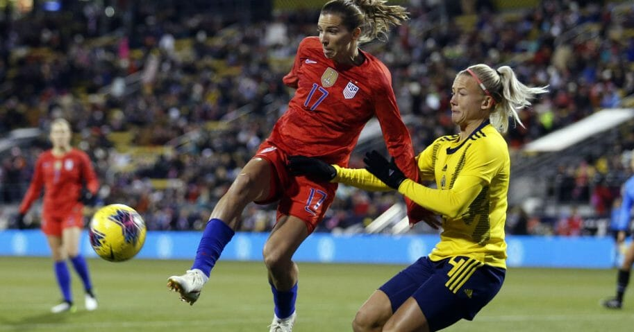 United States forward Tobin Heath, left, passes the ball in front of Sweden defender Hanna Glas during the first half of a women's international friendly soccer match in Columbus, Ohio, on Nov. 7, 2019.