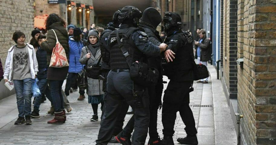 Police apprehend a man