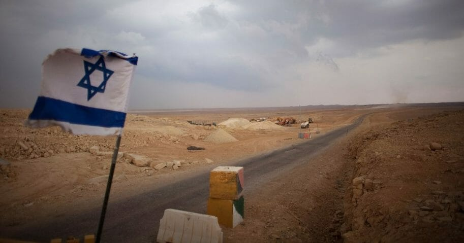 An Israeli flag flies at a checkpoint at the Israeli Egyptian border in Israel.