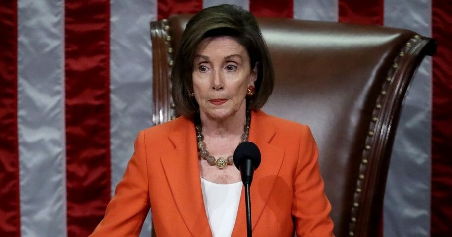Speaker of the House Nancy Pelosi gavels the close of a vote by the U.S. House of Representatives on a resolution formalizing the impeachment inquiry.